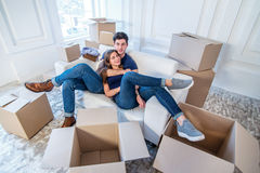 Moving home and repair of a new life. Couple in love pulls thing Stock Photos