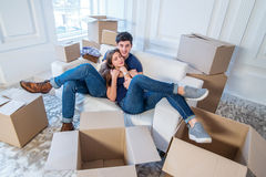 Moving home and repair of a new life. Couple in love pulls thing Royalty Free Stock Photo