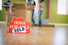 Moving: Home For Sale Sign Sits In Front Of Packing Supplies Royalty Free Stock Images