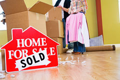 Moving: Home For Sale Sign Sits In Front Of Packing Supplies Stock Photos