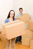 Moving home young couple carrying cardboard boxes Stock Photography