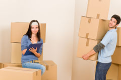 Moving home young couple carrying cardboard boxes royalty free stock photo