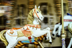 Moving horses on classic french carousel Royalty Free Stock Photography