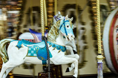 Moving horses on classic french carousel Stock Photo