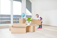 Moving house. A little girl have fun to help to moving house Stock Image