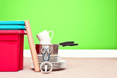 Moving house. Plastic storage crates and household items ready for storage Stock Image