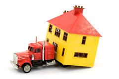 Moving house. Moving a house with a truck studio isolated Royalty Free Stock Photo