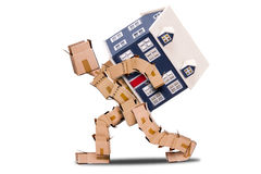Moving House box character concept. Moving house concept with character made of boxes with a home on his back isolated on a white background royalty free stock photos