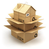 Moving house.  Cardboard box as home  on white. Real est Stock Photography