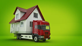 Moving a house with a truck. Royalty Free Stock Photography