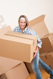 Moving house: Woman holding big carton box Stock Photo