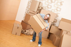 Moving house: Woman holding big carton box Royalty Free Stock Photo