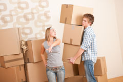 Moving house: Young couple with box Stock Photography
