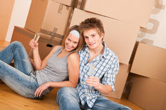 Moving house: Young couple celebrating Royalty Free Stock Image