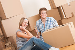 Moving house: Young couple celebrating Royalty Free Stock Photos