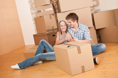 Moving house: Young couple celebrating Stock Images