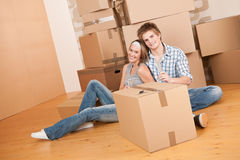Moving house: Young couple celebrating Stock Photos