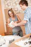 Moving house: Young couple unpacking dishes Stock Photo