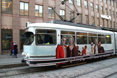 Moving HSL Tram with Tommy Hilfiger Advertisement. HELSINKI, FINLAND - DECEMBER 18: Moving tram with Tommy Hilfiger advertisement on December 18, 2013  in Stock Photography