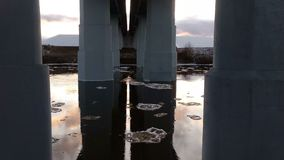 Moving ice floes under the bridge. Winter landscape with moving ice floes under the bridge stock footage