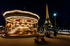 Moving Illuminated Vintage Carousel and Eiffel Tower, Paris, Fra Royalty Free Stock Photo