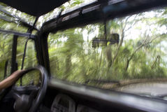 Moving Jeep. Jeep in motion, passengers view with motion blur Stock Images