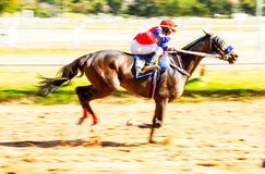 moving jocky and horse racing sport Stock Images