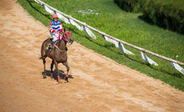 moving jocky and horse racing sport Stock Photos