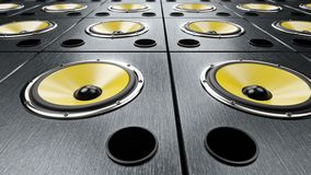 Moving left to right over audio speakers yellow membranes playing modern music