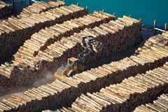 Moving logs at a busy port. Aerial view of moving logs at a port Royalty Free Stock Photos