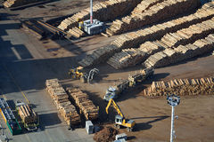 Moving logs at a busy port. Aerial view of moving logs at a port Stock Photo