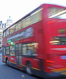 A moving London bus. Royalty Free Stock Photography
