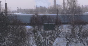 Moving long freight train on railway at winter morning. 4k stock video footage