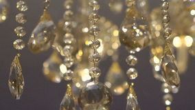 Moving of a luxury crystal gold chandelier. Beautyful background. Slowly stock video