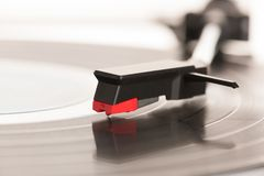 Moving magnet cartridge on the tonearm standing on a vinyl recor. D Royalty Free Stock Photos