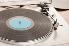Moving magnet cartridge on the tonearm standing on a vinyl recor. D Stock Image