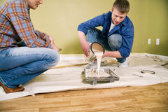 Moving: Man Pours Paint In Tray Before Starting To Paint Royalty Free Stock Photography
