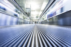 Moving modern escalator way Stock Images