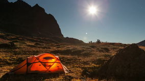 Moving moon above tent at night time lapse Stock Footage