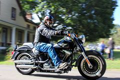 Moving motorcycle. Man enjoying a beautiful day Royalty Free Stock Images