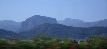 Moving Mountains. Tramuntana mountains in central Majorca seen from the road with speed blur in July. Malloca, Spain Stock Photography