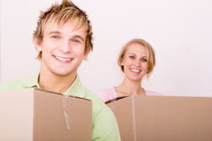 Moving in new home. Young couple moving in new home Stock Images