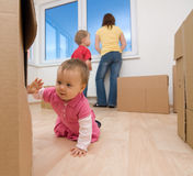 Moving into new home. Family with cardboard moving boxes moving into new home Stock Photography