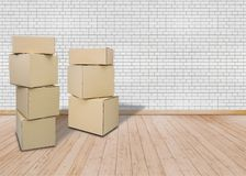 Moving in new home or apartment, offic Empty room with Brown Carton boxes stock photos