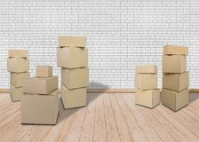 Moving in new home. Empty room with Carton boxes stock photo