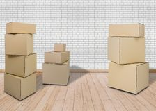 Moving in new home. Empty room with Carton boxes stock image