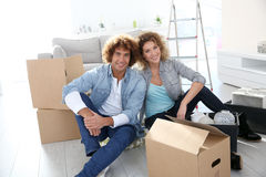 Moving in new home. Couple getting in their new apartment to live together Royalty Free Stock Photos