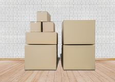 Moving in new home. Empty room with Carton boxes royalty free stock photos