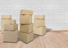 Moving in new home. Empty room with Carton boxes royalty free stock image