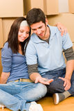 Moving new home young couple hold keys Royalty Free Stock Photos